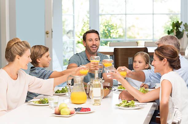 Generation family toasting stock photo