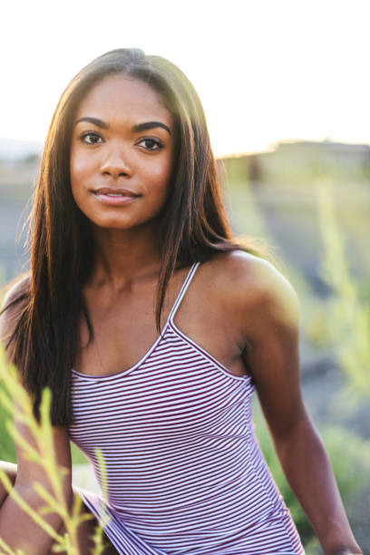 Generation Z Attractive African American Female Outdoor Portraits at Sunset stock photo