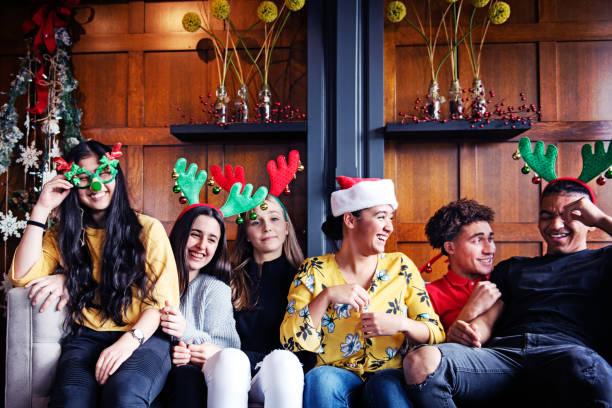 generation z christmas party with multi-ethnic friends - manonallard stock photos and pictures