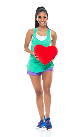 Generation z female sleeveless standing in front of black background wearing tank top