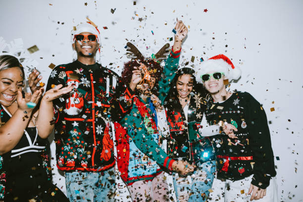 generation z friends christmas photo booth - ugly sweater stock pictures, royalty-free photos & images