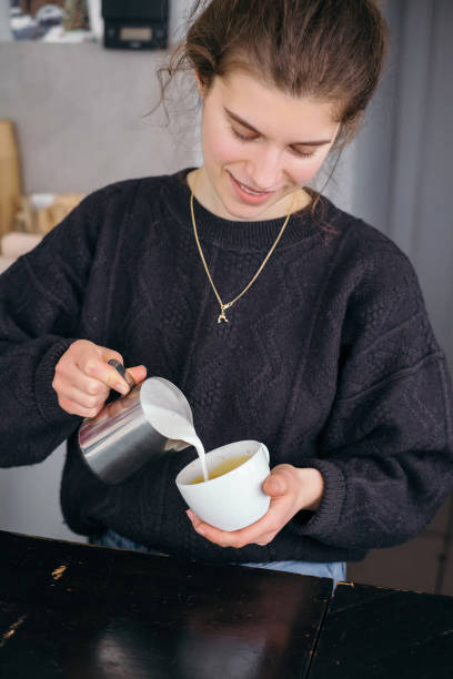 Generation Z girl working in cafe and making coffee stock photo
