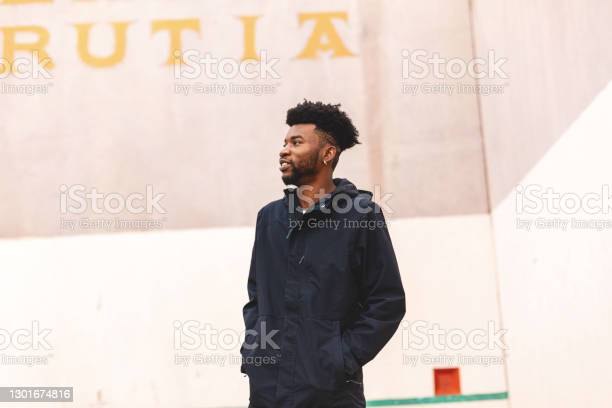 Generation Z Male Having Fun And Messing Around On A Hand Ball Court Photo Series Stock Photo - Download Image Now
