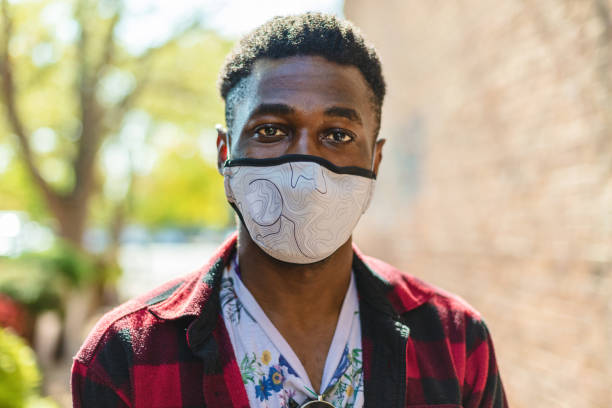 Generation Z Male of African Ethnicity Wearing a Face Mask in the City  Photo Series In Western Colorado Generation Z Male of African Ethnicity with Face Mask for Protection During Pandemic or Environmental Pollution Photo Series Matching 4K Video Available (Shot with Canon 5DS 50.6mp photos professionally retouched - Lightroom / Photoshop - original size 5792 x 8688 downsampled as needed for clarity and select focus used for dramatic effect) eyecrave stock pictures, royalty-free photos & images