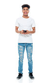 istock Generation z teenage boys standing in front of white background wearing shirt and using mobile phone 1208644129