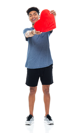 Generation z teenage boys standing in front of white background wearing sports shoe