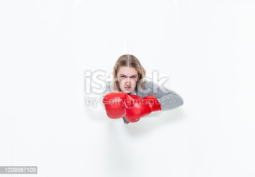521301688 istock photo Generation z teenage girls high school student in front of white background wearing boxing glove 1209587103