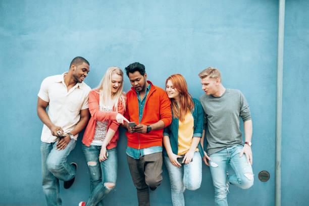 generation z using smartphones stock photo