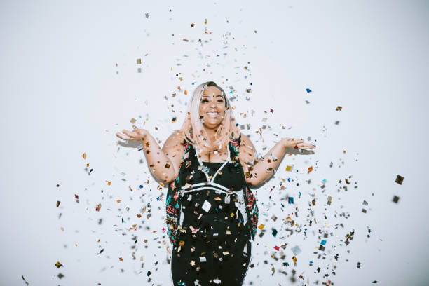 Generation Z Young Woman Celebrates With Confetti stock photo