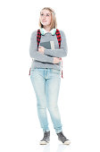 istock Generation z young women junior high student standing in front of white background wearing warm clothing and holding book and using headphones 1223892962