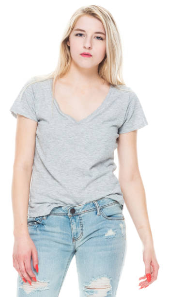 Generation z young women standing in front of white background wearing t-shirt stock photo
