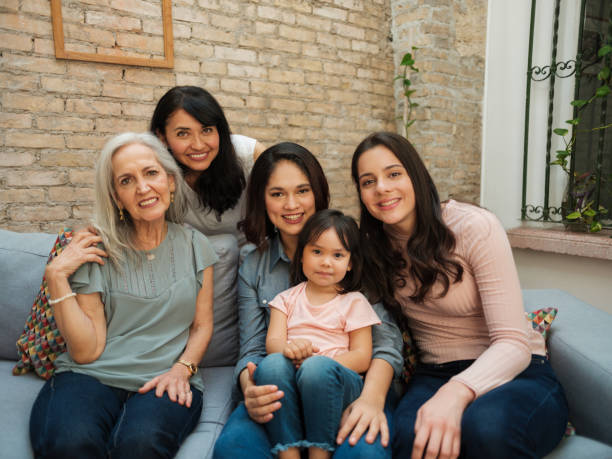 Generations of women from the same Mexican family stock photo