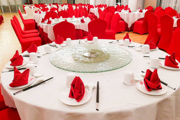 Generic Chinese wedding dinner banquet set-up with dinnerwares Typical generic Chinese wedding dinner banquet set-up with dinnerware arranged chinese wedding dinner stock pictures, royalty-free photos & images