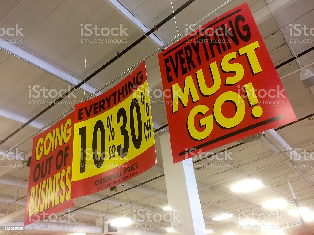 generic going out of business signs stock photo