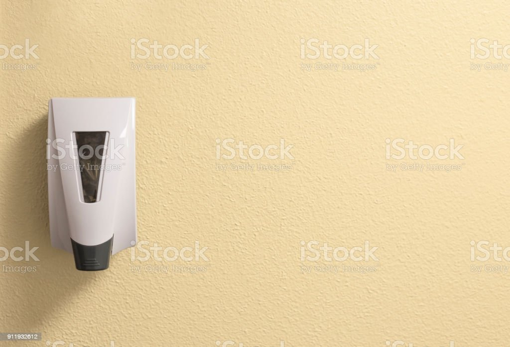 Generic Hand Sanitizer Dispenser on a Textured Cream Wall with Space to Add Writing or Text stock photo