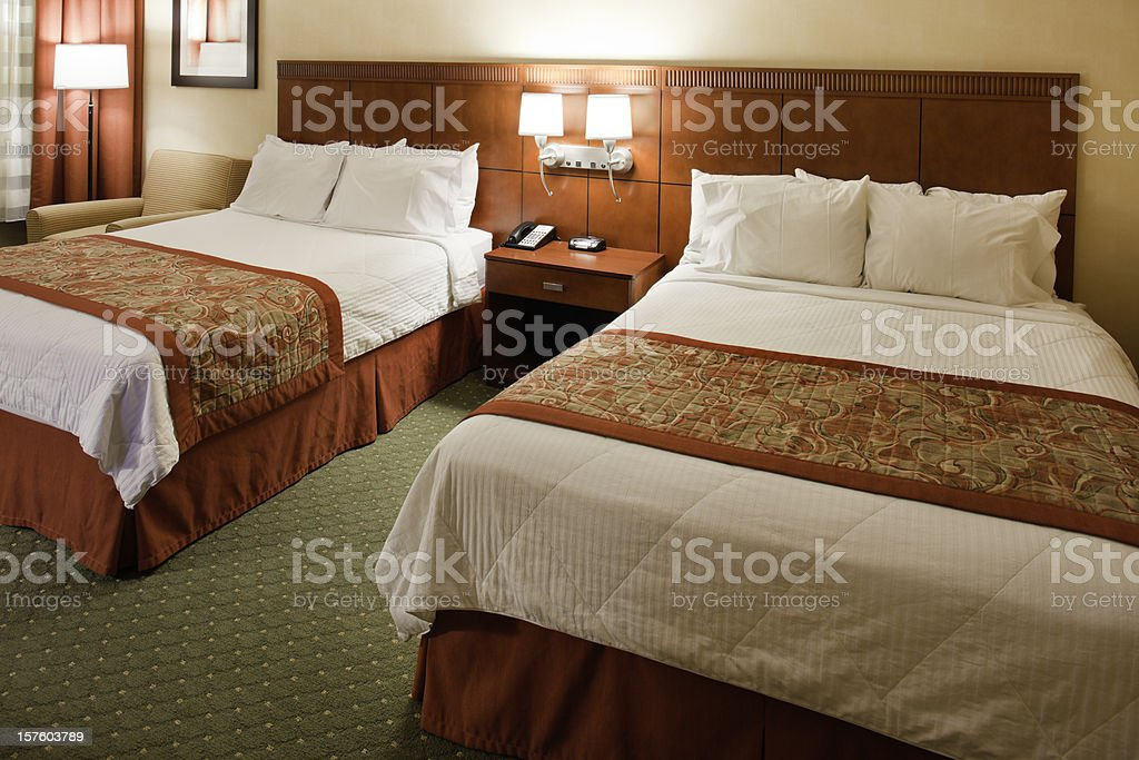 generic hotel room with two queen beds royalty-free stock photo