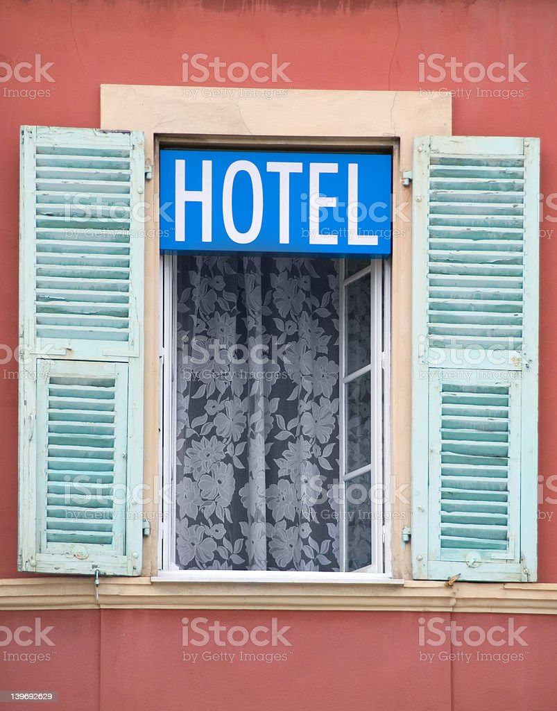 Generic hotel sign in window, Nice, France royalty-free stock photo
