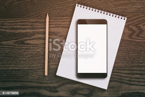 istock generic modern smartphone on notepad with pencil 914979856