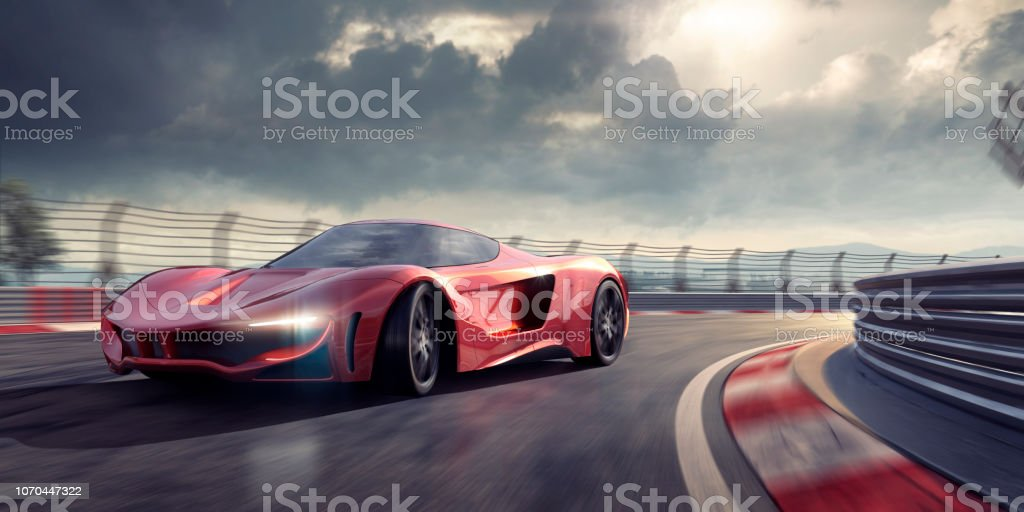 Generic Red Sports Car Cornering Around Bend In Racetrack stock photo