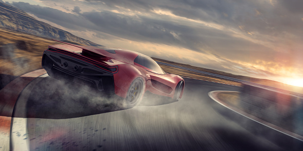 A generic red sports car moving at high speed around the corner of a racetrack. The vehicle is drifting around the corner, with smoke coming from its spinning rear tires. The racetrack is fictional in a remote location near to hill. It is sunset under a cloudy evening sky.