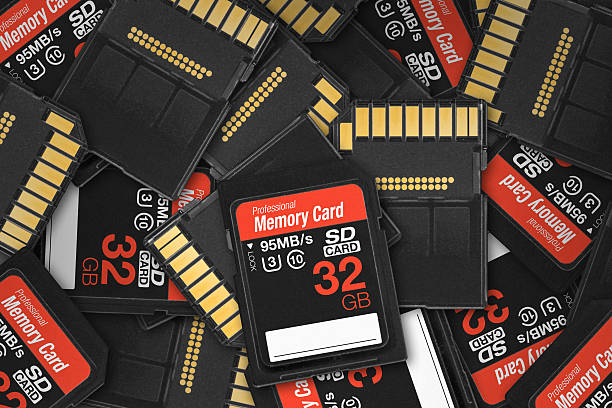 generic sd card pile - memory card stock photos and pictures