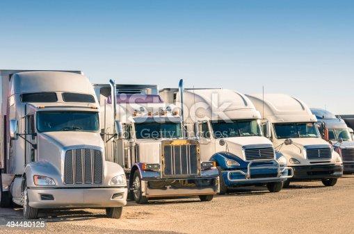 istock Generic semi-trucks in a parking lot 494480125
