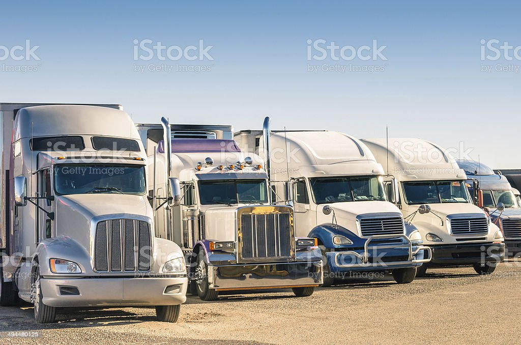 Generic semi-trucks in a parking lot stock photo