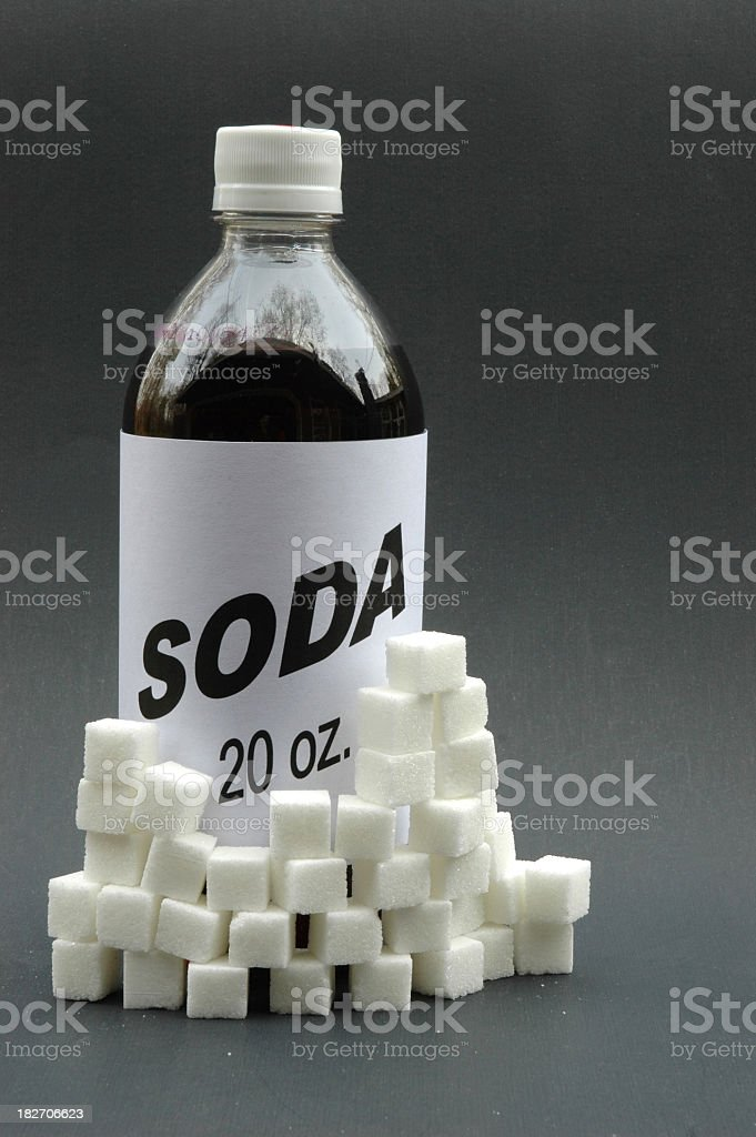 Generic soda with sugar cubes stacked around it stock photo