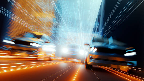 Generic speeding cars in futuristic city stock photo