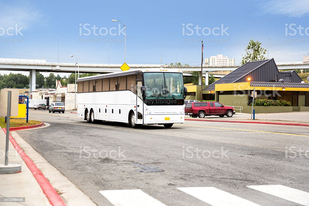 Generic Tour bus in parking lot stock photo