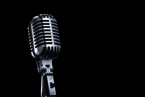 Generic Vintage Microphone on a Black Background The microphone is isolated on a black background. Focus falls off on the top a little bit.click on the links below to view lightboxes. microphone stock pictures, royalty-free photos & images