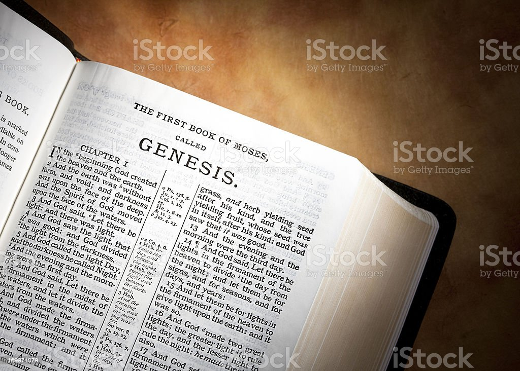 Genesis in the KJV Bible on Parchment Paper stock photo
