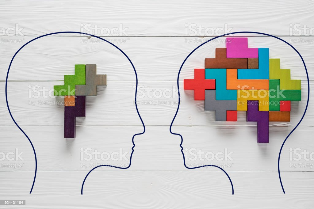 Genetic Brain disorder. Health and ailing brain. Mental health and mental disorder concept. Heads with shapes of abstract brain. Two human heads silhouette with small and big brain. Brain Diseases. stock photo