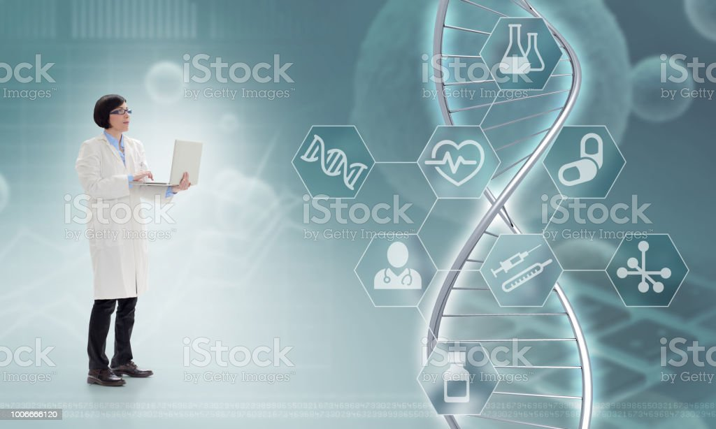 doctor holding a laptop in front of a DNA hologram in a blue-grey...