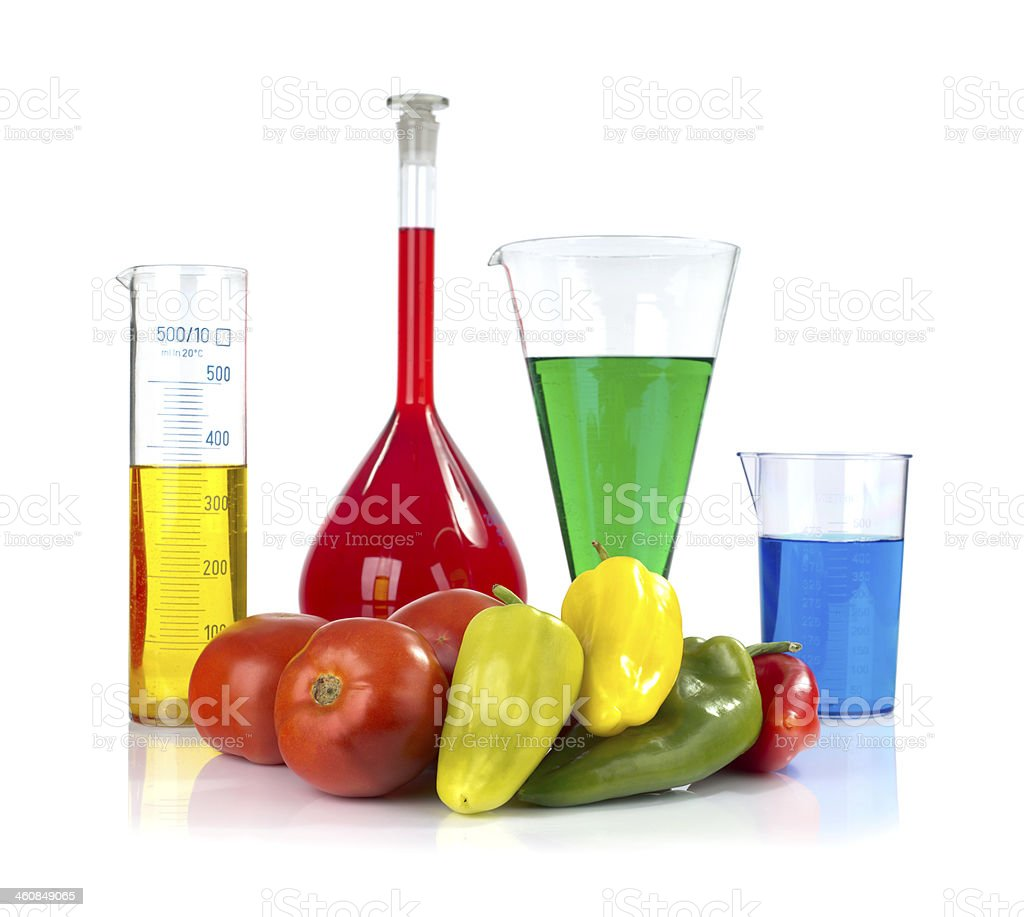 Genetically modified organism - ripe peppers,  tomatoes  and laboratory glassware stock photo