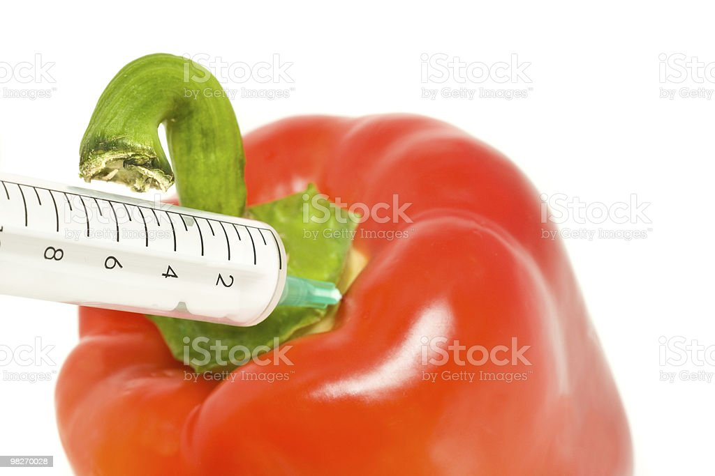 Genetically modified products - pepper and syringe royalty-free stock photo
