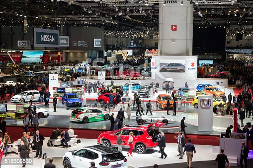 Geneva, Switzerland - March 1, 2016: People and cars at the 86th International Geneva Motor Show in Palexpo, Geneva.