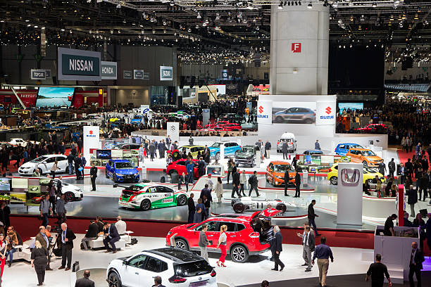 Geneva Motor Show 2016 overview Geneva, Switzerland - March 1, 2016: People and cars at the 86th International Geneva Motor Show in Palexpo, Geneva. car show stock pictures, royalty-free photos & images