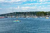 2019 Geneva, Switzerland.  Pedallo in the harbour near the lakeshore promenade and the jetties in Geneva.