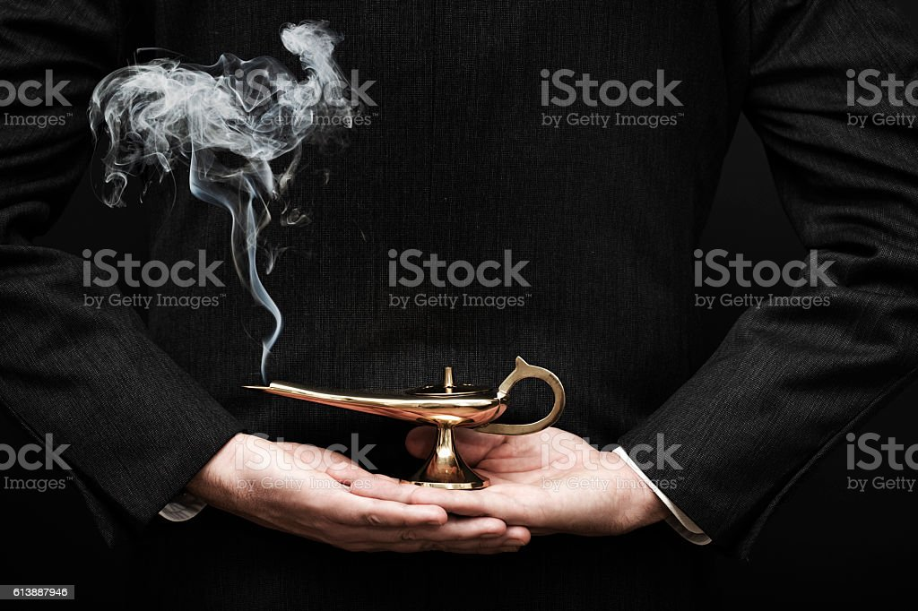Genie coming out from Aladdin lamp stock photo