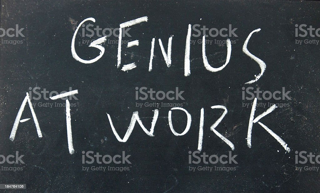 genius at work title written with chalk on blackboard royalty-free stock photo
