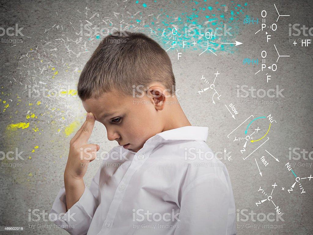 Genius boy solving science problem stock photo
