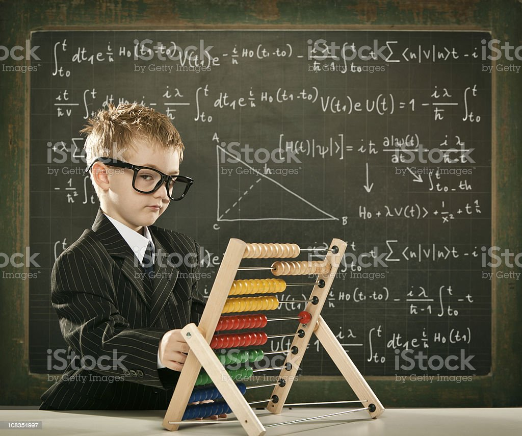 genius student or teacher boy with abacus on school blackboard royalty-free stock photo