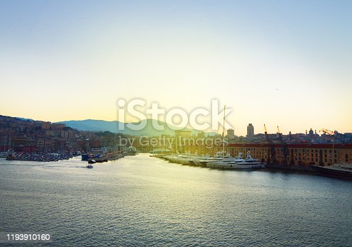 istock Genoa, Italy-October 13, 2018: panorama of the old port with harbour cranes, pier, yachts, sea view, early morning, dusk and early sunrise 1193910160
