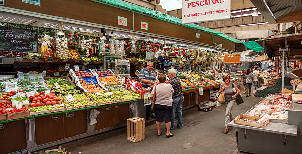 Genoa - People buying fresh food in the Mercato Orientale Genoa, Italy - August 19, 2015: Inside the Mercato Orientale where local customers buy fresh fruits and vegetables. asian market stock pictures, royalty-free photos & images