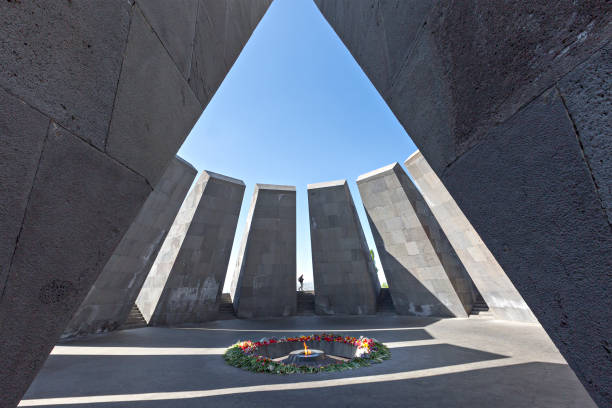 Genocide memorial, Yerevan, Armenia. Yerevan, Armenia - April 27, 2017: Armenian genocide memorial monument with eternal flame and flowers, in Yerevan, Armenia. armenian genocide stock pictures, royalty-free photos & images