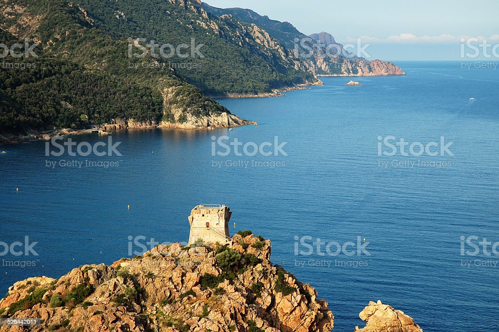 Genoese tower near the sea in Porto, Corsica stock photo