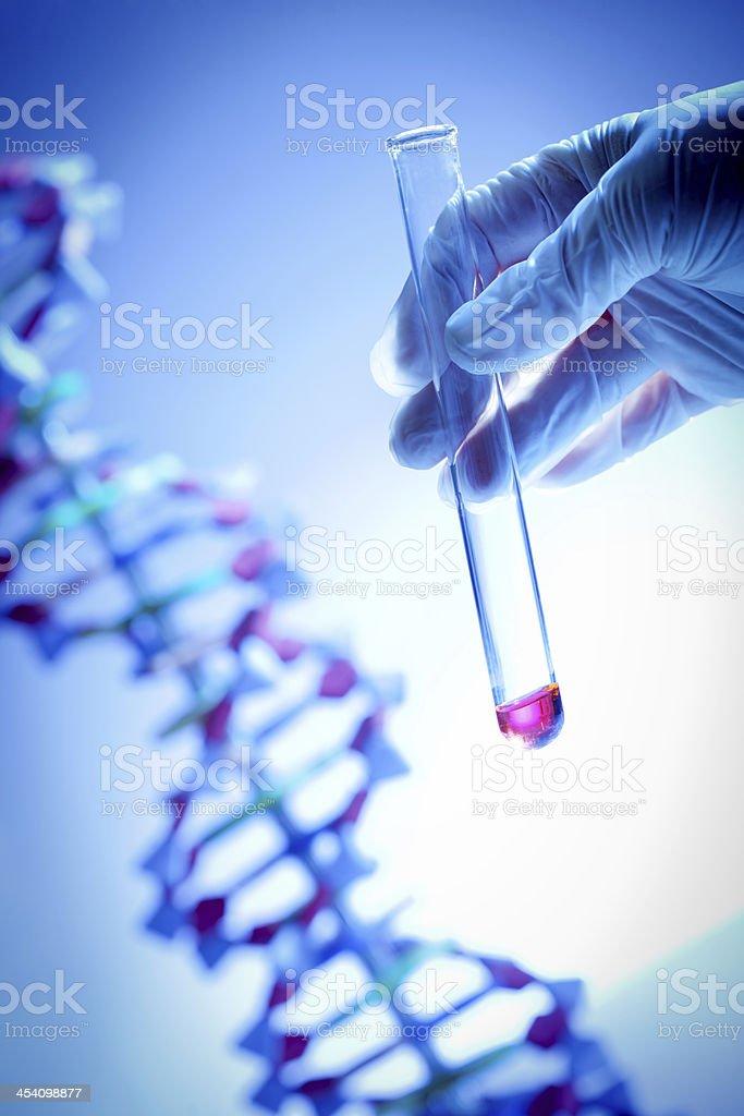Genome Project with DNA Genetic Sample Held in Test Tube stock photo