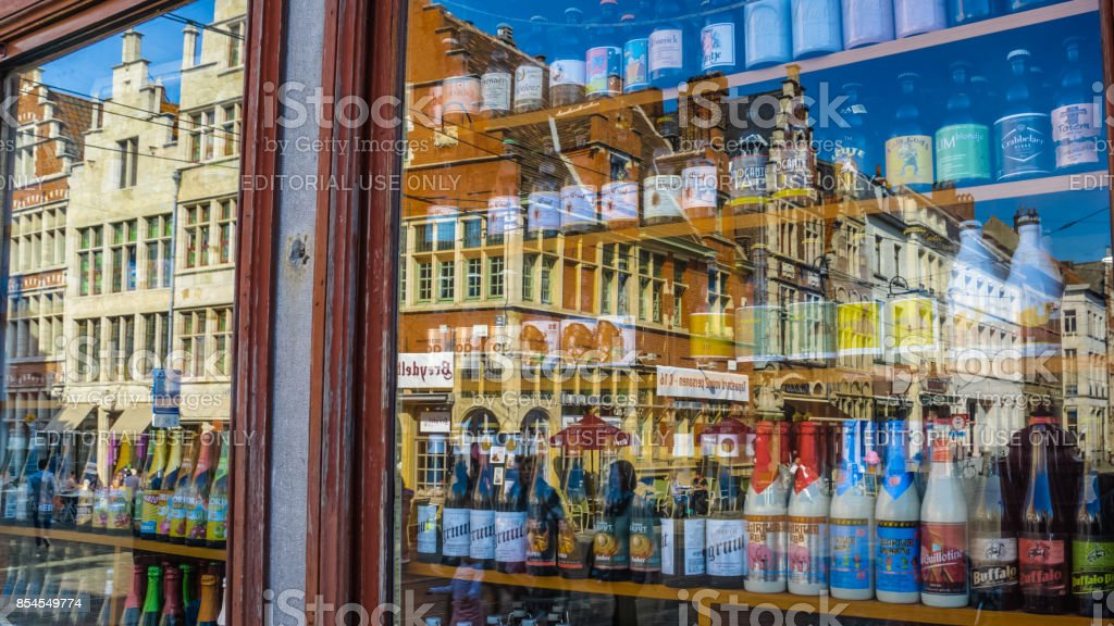 Gent, Belgium  Shop window with a variety of beers. the old buildings next to Sint Veerleplein are visible in the reflection. stock photo