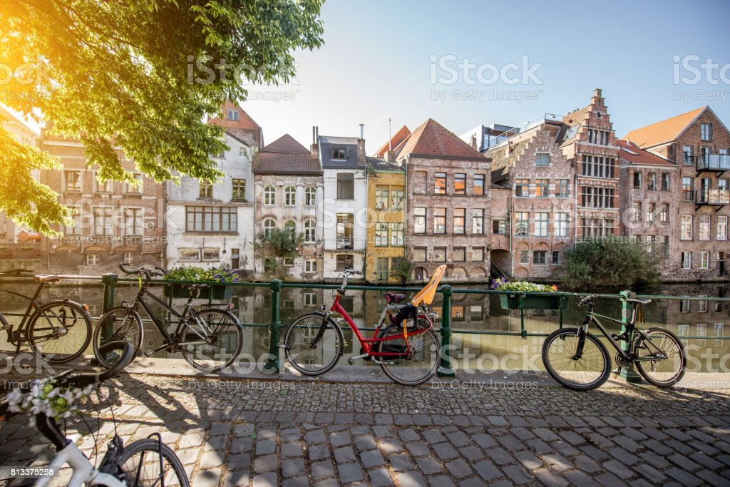 Gent city in Belgium Riverside view with beautiful old buildings and bicycles during the morning light in Gent city, Belgium Architecture Stock Photo